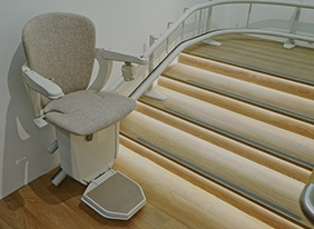 much domestic stair lifts cost featured image of curved stair lift